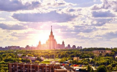 Sunny campus of famous Russian university under cloudy sky