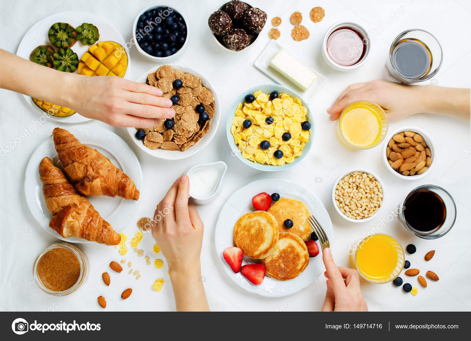 Breakfast table setting with flakes juice croissants pancakes and fresh berries. toning. selective focus u2014 Photo by nata_vkusidey & Breakfast table setting with flakes juice croissants pancakes ...