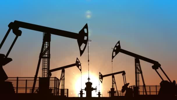Looped oil pumpjacks against blue sunset sky