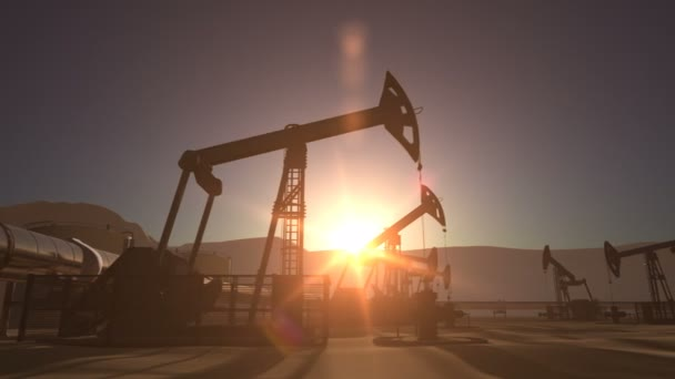 Sunrise over oil field with pumpjacks and pipeline