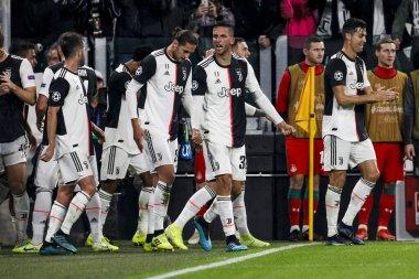 TURIN, ITALY - OCTOBER 22ND, 2019. UEFA CHAMPIONS LEAGUE, JUVENTUS vs LOKOMOTIV MOSCOW 2-1: Players of Juventus celebrating the goal of Paulo Dybala.