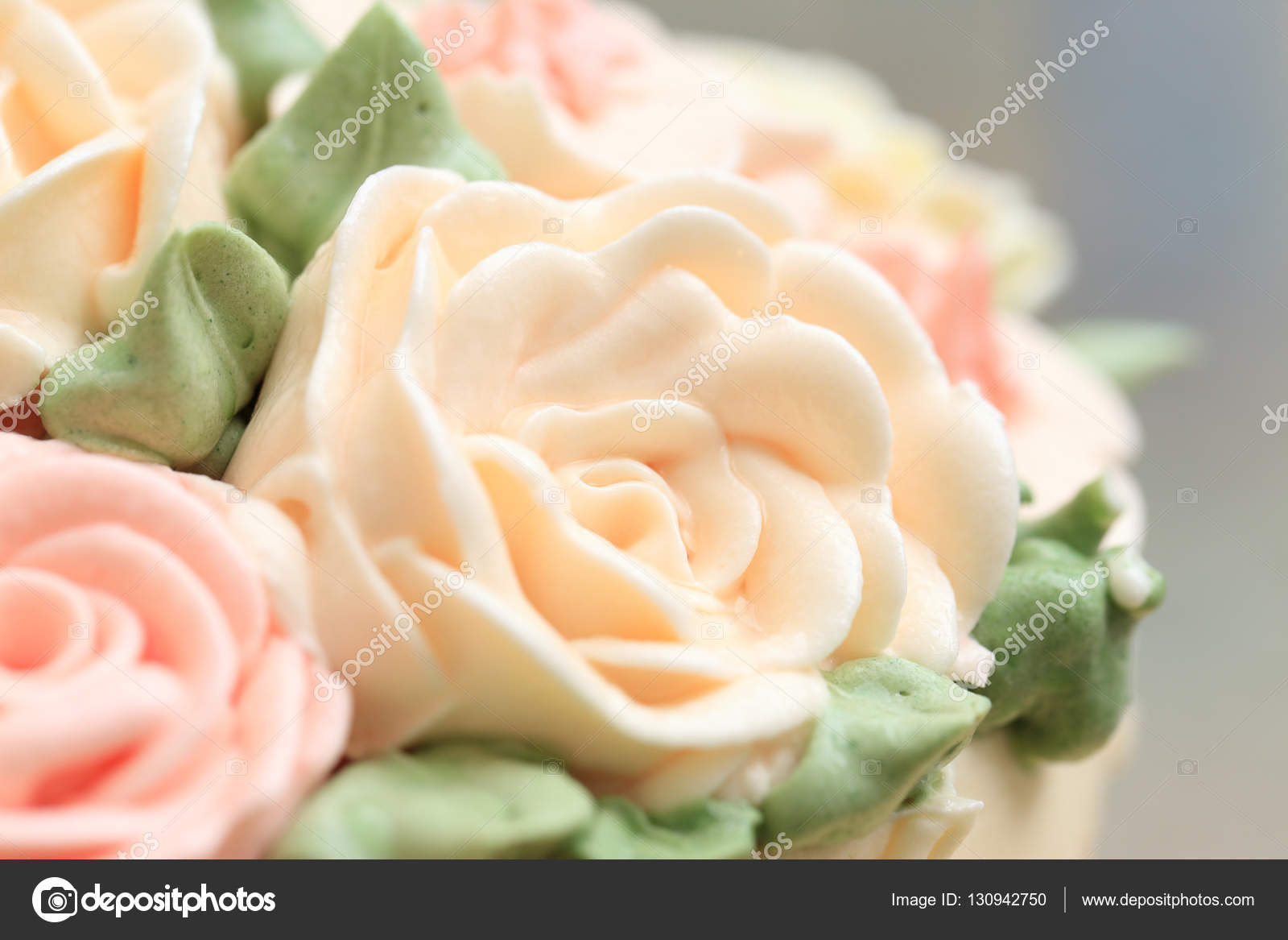 Close Up Of Flowers Made From Cream On Wedding Or Birthday Cake