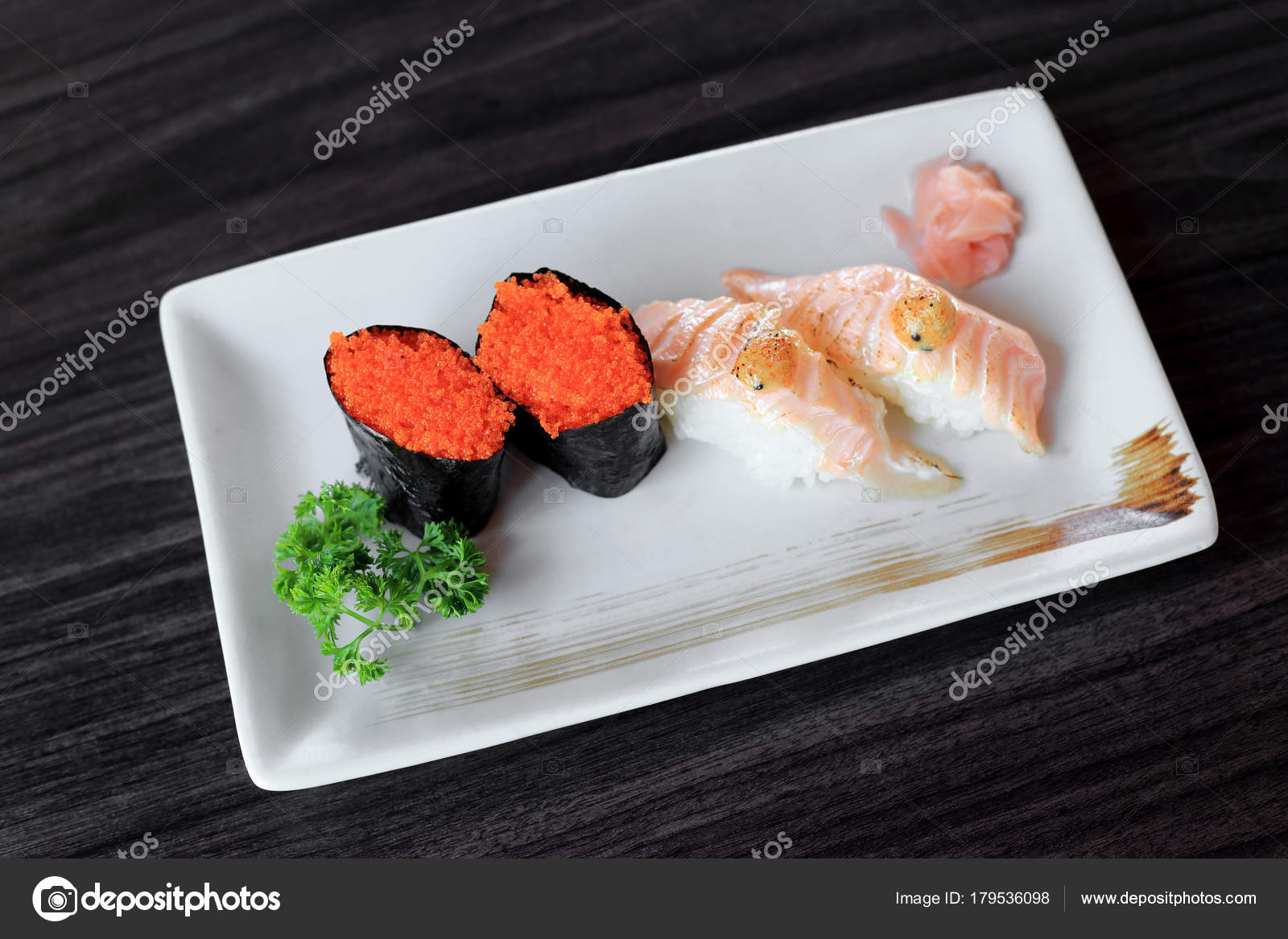 Maki Sushi With Flying Fish Roe And Salmon Grilled Nigiri Sushi Stock Photo Image By C Enrouteksm 179536098