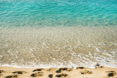 Clear water and footprints at Cleopatra beach