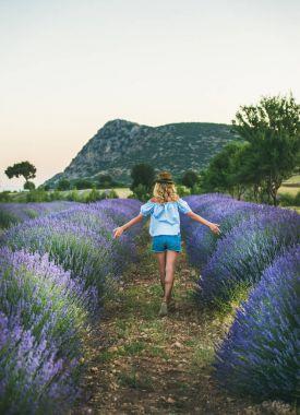 Woman walking in lavender field