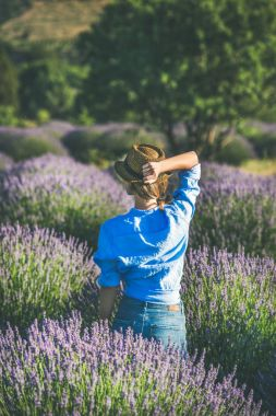 woman enjoying lavender field