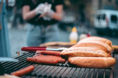 Delicious fresh hot dogs on the grill