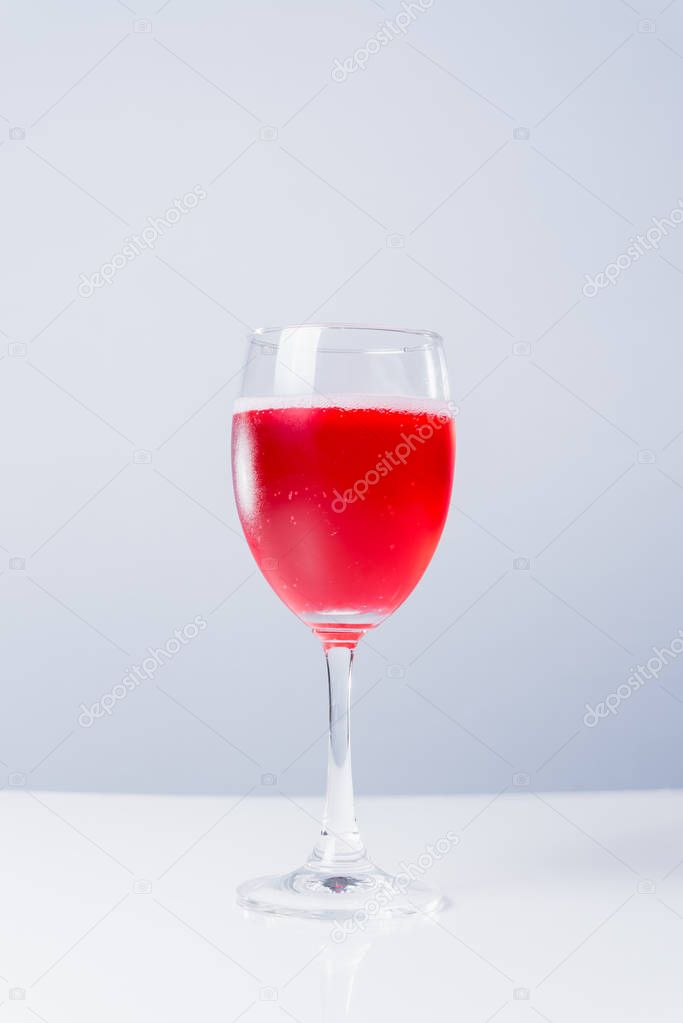 isolated glass with red wine on white background