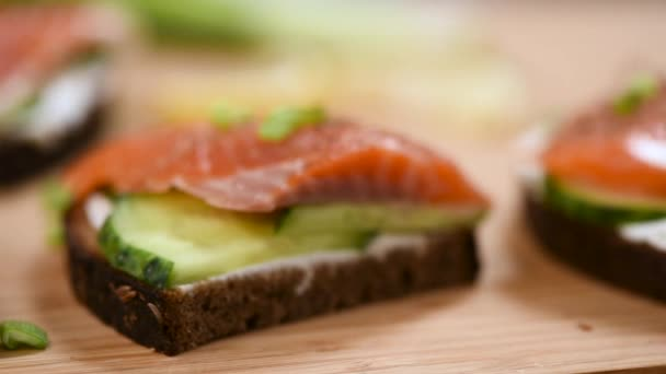 Closeup shot of smoked salmon rye bread sandwiches with cream cheese and cucumber