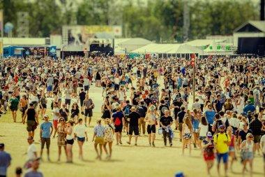 FESTIVAL PARK, WERCHTER, BELGIUM - JUNE 30, 2019: Crowd of visitors at Rock Werchter annual music festival