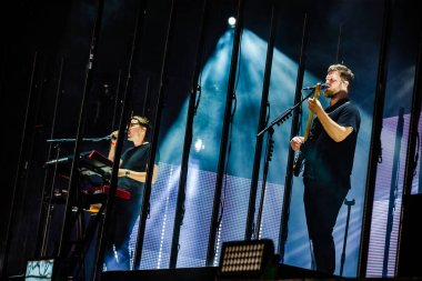 alt-J performing on stage during  music festival