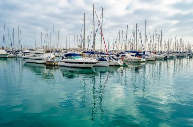 ALICANTE, SPAIN - DECEMBER 27, 2018: View of sailboats and yachts in the Mediterranean port of Alicante, Spain