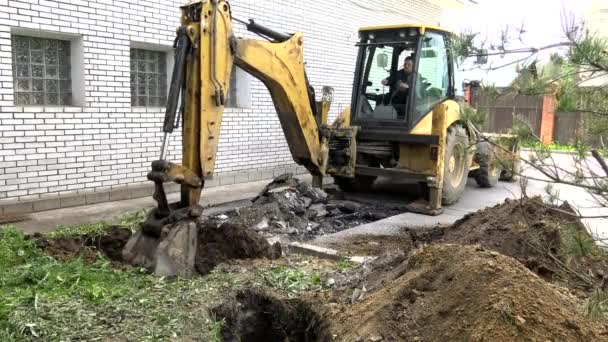 Bucket Tractor excavator delivers sand.