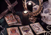 Fotografie Tarot cards, mirror and burning candle.