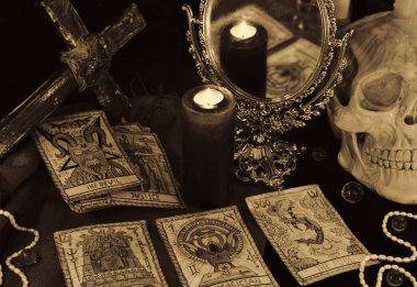 Tarot cards, mirror and burning candles.