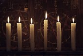 Fotografie Mystic close up wih burning candles against wooden background