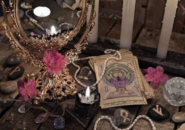 Close up with the tarot cards, mirror and black candle
