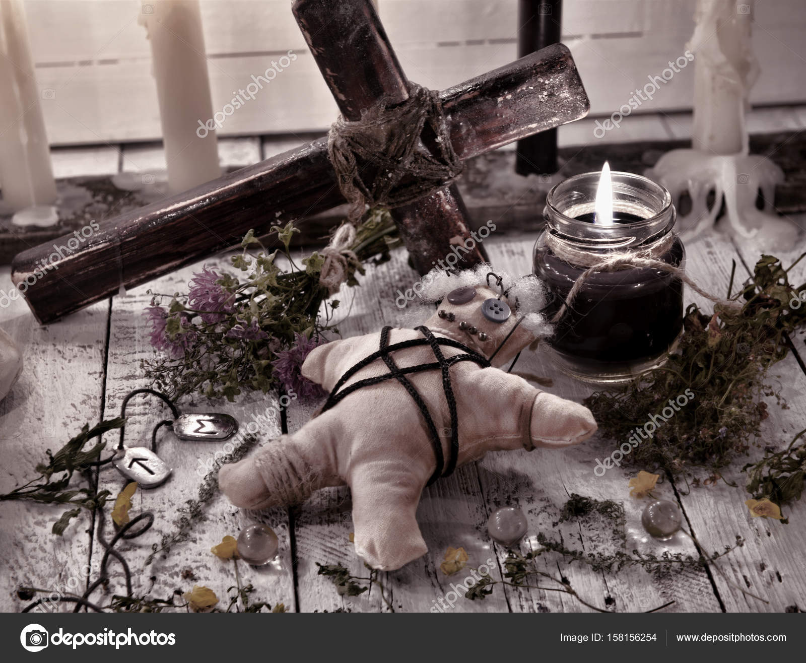 Voodoo Doll With Cross Herbs And Black Candle Stock Photo