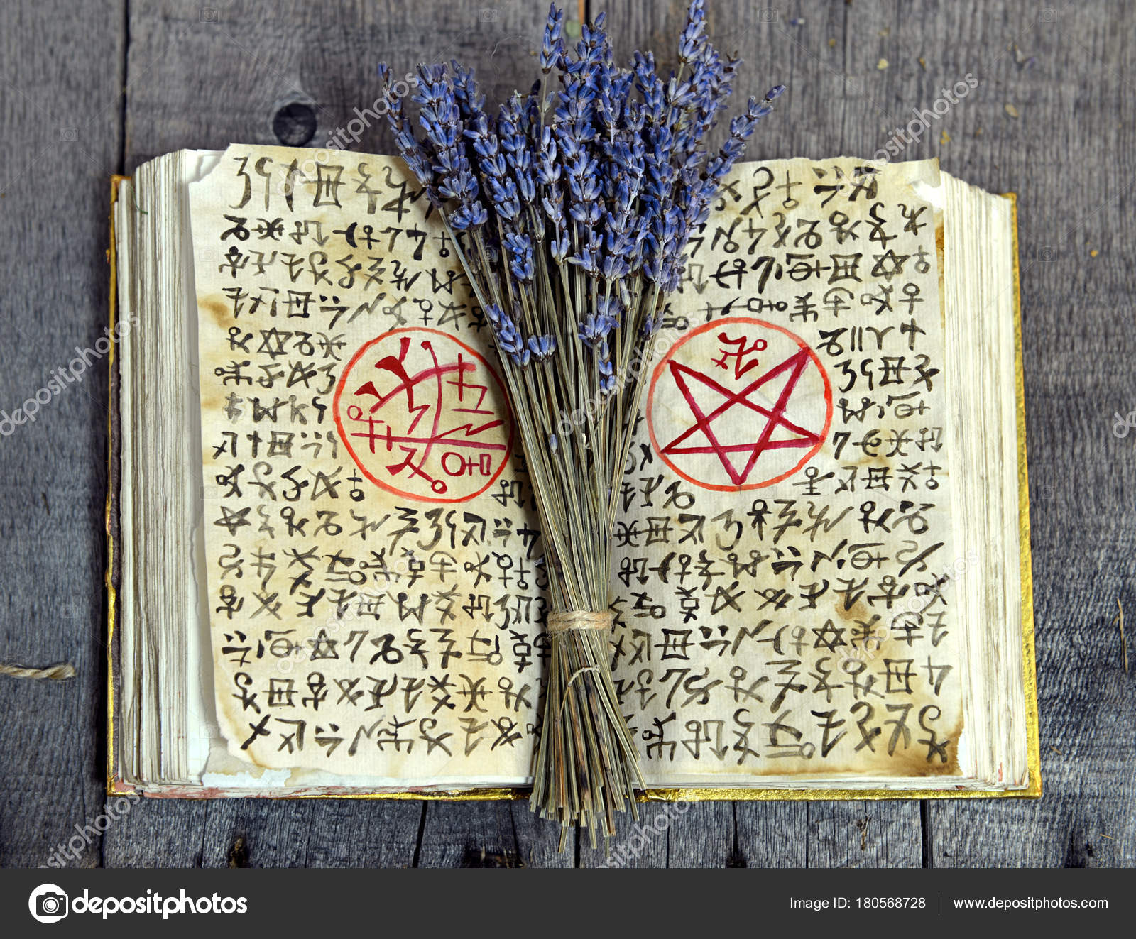 Old book black magic symbols lavender bunch witch table occult old book with black magic symbols and lavender bunch on witch table occult esoteric divination and wicca concept halloween vintage background biocorpaavc