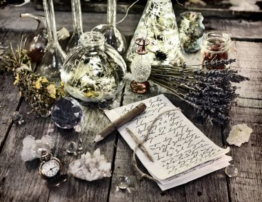Witch manuscript with pencil, magic bottles, crystals, old clock and lavender flowers on planks. Halloween, occult, esoteric and wicca concept. Vintage background stock vector
