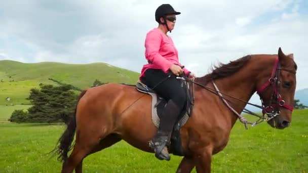 Professional horse riders riding horses slow motion. Women in helmets horseman. Summer activity, sports at hippodrome with protection. Brown bay horse racing, races betting