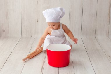Little baby chef in apron.