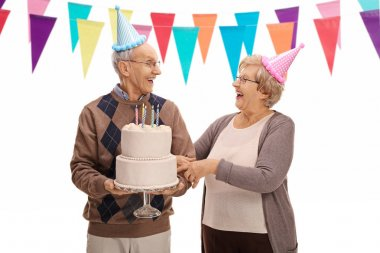 Seniors celebrating a birthday and looking at each other