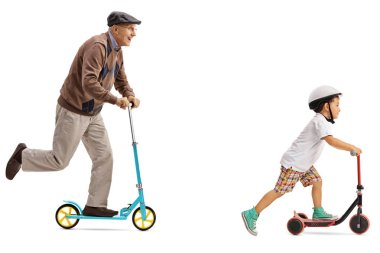 Elderly man and a little boy riding scooters