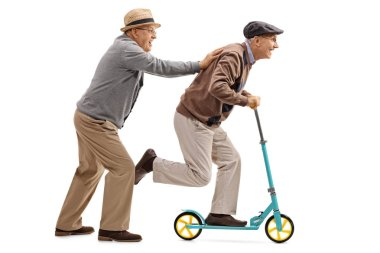 Mature man pushing another man on a scooter