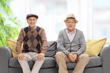 Seniors sitting on a sofa