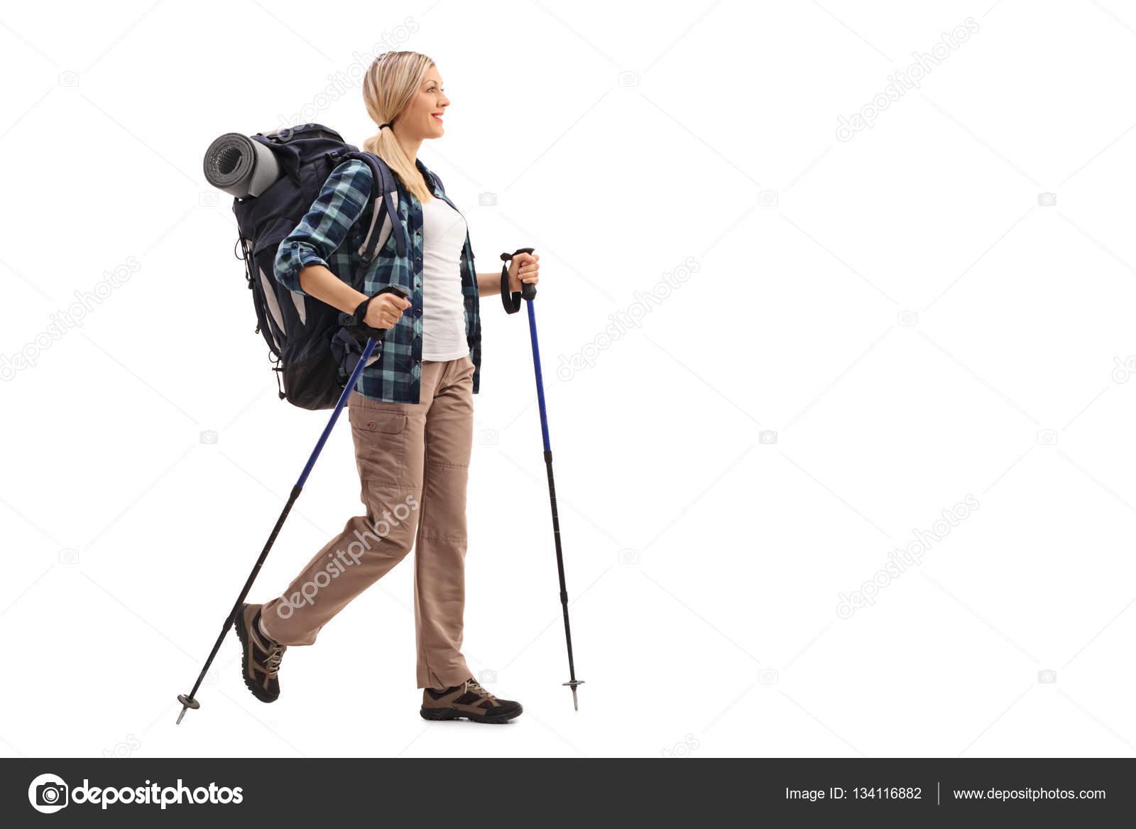 0321a7aa59fdb Femme avec marche de matériel de randonnée– images de stock libres de droits
