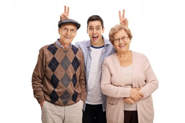 Man pranking a mature man and woman with bunny ears