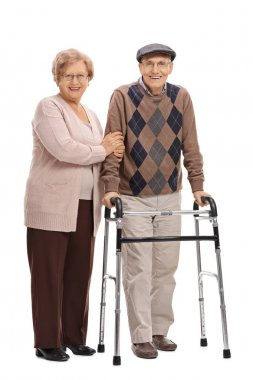 Mature woman and a mature man with a walker