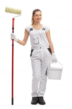 female decorator with paint roller and paint bucket
