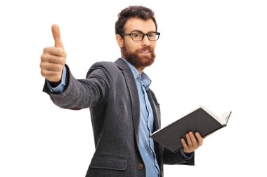 man giving a thumb up and holding a book