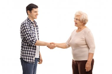 man shaking hands with an elderly woman
