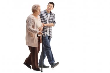 Elderly woman walking with a young man