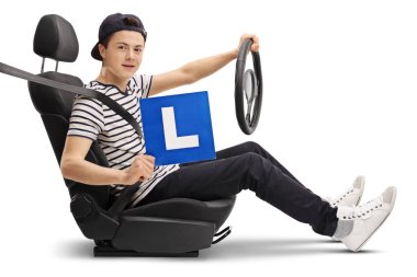 Teenage driver in a car seat showing an L-sign