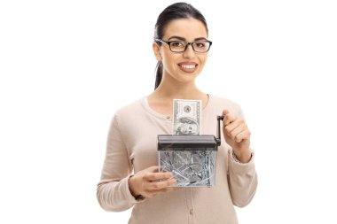 woman destroying a dollar banknote in a paper shredder