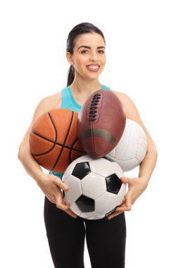 woman holding different kinds of sports balls
