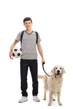 Teenage student with a dog and a football