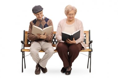 Seniors sitting on a bench and reading books