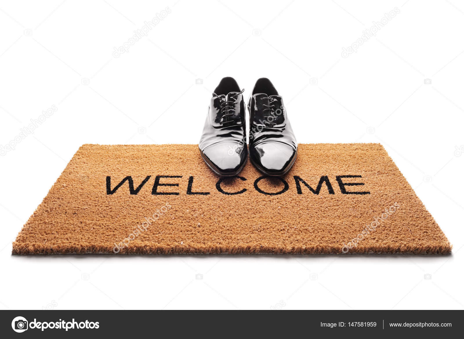 Shoes on a doormat with the word welcome stock photo shoes on a doormat with the word welcome stock photo 147581959 publicscrutiny Images