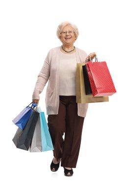 Joyful mature woman with shopping bags