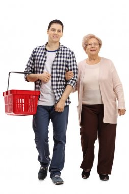 Guy with a shopping basket and a mature woman walking