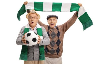 Excited elderly football fans cheering