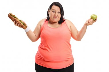 Indecisive overweight woman holding a sandwich and an apple isolated on white background stock vector
