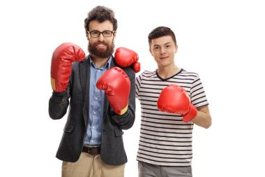 Father and son posing with boxing gloves