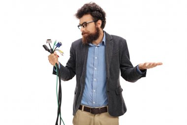 man holding different types of electronic connectors