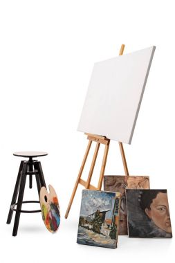 Chair, palette, canvas and paintings